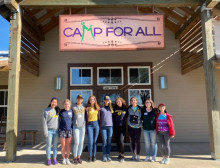 Image of students in front of camp sign