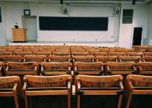 Photo of an empty lecture hall.