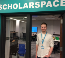 Mitchell Lawrence in doorway of ScholarSpace
