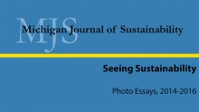 """Blue slide from MJS exhibit that says """"Michigan Journal of Sustainability, Seeing Sustainability, Photo Essays, 2014-2016."""""""
