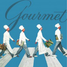 Four chefs walking in a line.