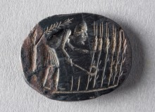 Sciatica Amulet; Egypt; in Greek; 1st-5th century AD; Hematite, black; 18 x 23 x 3 mm; SCL-Bonner 40