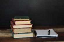 school books and pen
