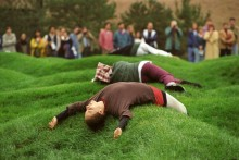 Wave Field: students lying on grass-covered mounds