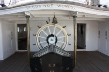 "Yacht wheelhouse with text ""Deeds not Words"""
