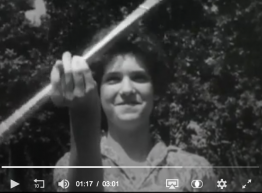 Still image from 1960s Texaco ad, girl with a baton