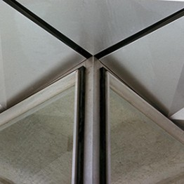 intersection of metal beam with ceiling