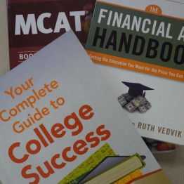 books in photo: your guide to college success, financial aid handbook, mcat