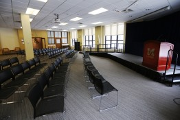 A picture of the gallery showing the stage, wheelchair accessible ramp and lecture seating