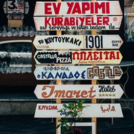 signboard with a variety of messages in greek