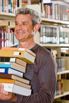 Library patron with a stack of books