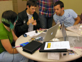 Students working together over a laptop.