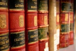 Photo of books on a shelf.