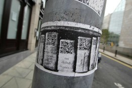 Photo of poster with QR codes on classic book titles