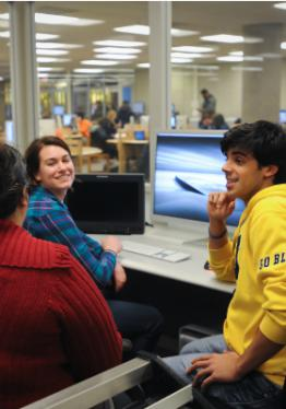 Photo of students in the library.