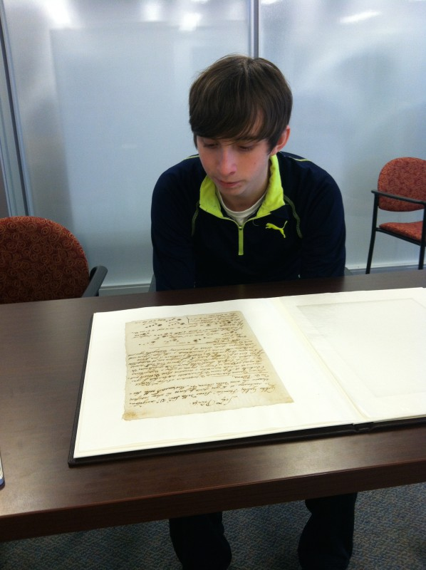 Image of student viewing Galileo Manuscript