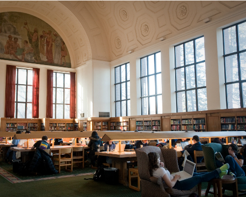 Photo of students studying in the reference room in Hatcher Library.