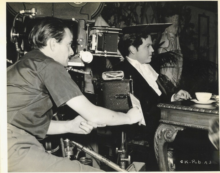 Orson Welles on set of Citizen Kane with camera visible